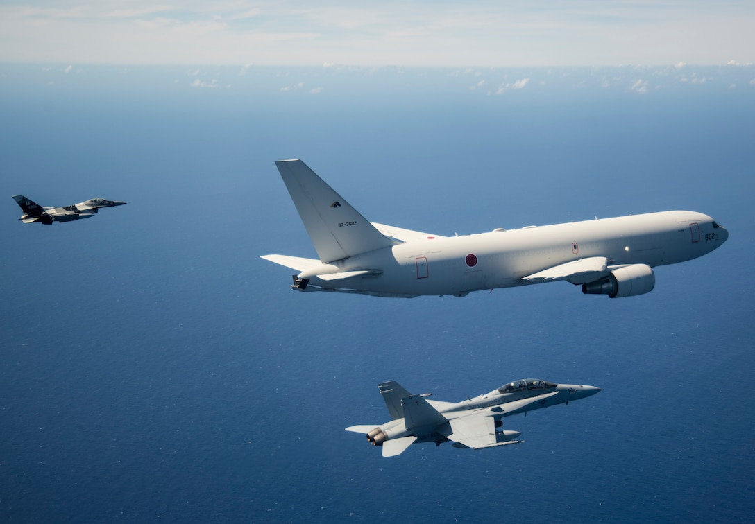 Aircraft from the United States and Japan participate in a COPE North 2019 airpower demonstration formation over the Pacific Ocean, March 6, 2019.