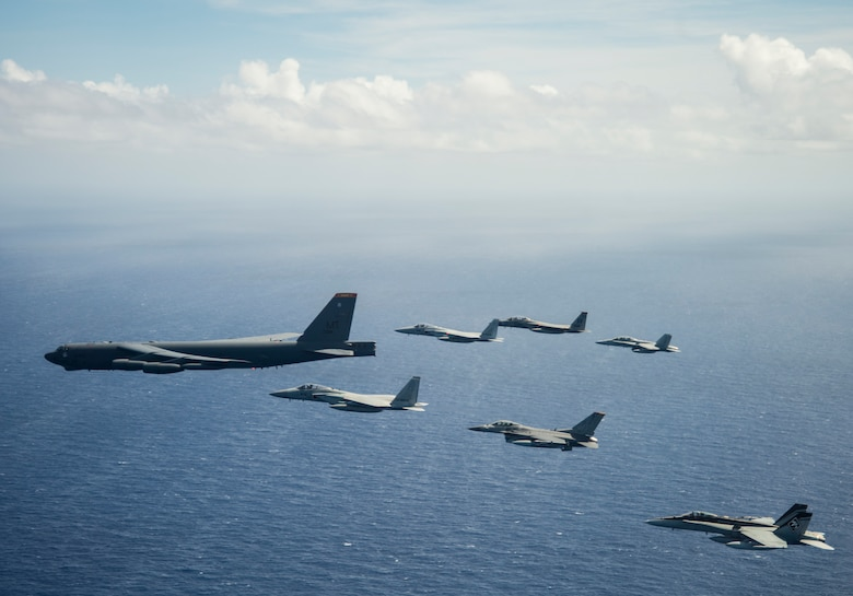 Aircraft from the United States, Australia and Japan participate in a COPE North 2019 airpower demonstration formation over the Pacific Ocean, March 6, 2019.