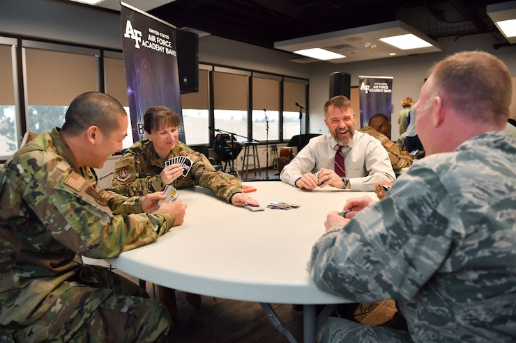 Col. Jennifer Grant, 50th Space Wing commander, and James Driscoll, 50th Space Wing acquisition program manager, play UNO during First Friday at the event center, Schriever Air Force Base, Colorado, March 1, 2019. These events support the 50th SW's priority of taking care of our Airmen and families always. (U.S. Air Force photo by Katie Calvert)