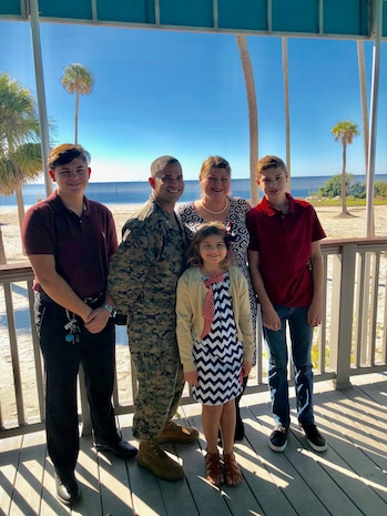Holly Vega, the 2019 Armed Forces Insurance Marine Corps Spouse of the Year, with her husband, Marine Corps Lt. Col. Javier Vega and their three children at MacDill Air Force Base, Florida.
