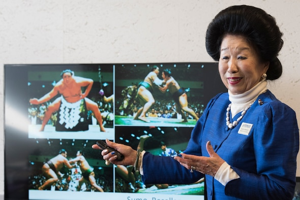 Yasuko Birkhead, 374th Force Support Squadron Japanese cultural adaptation instructor, gives a brief on Japanese traditional sports, Sumo, to attendees during Japanese customs and courtesies class at Yokota Air Base, Japan, Feb. 25, 2019.