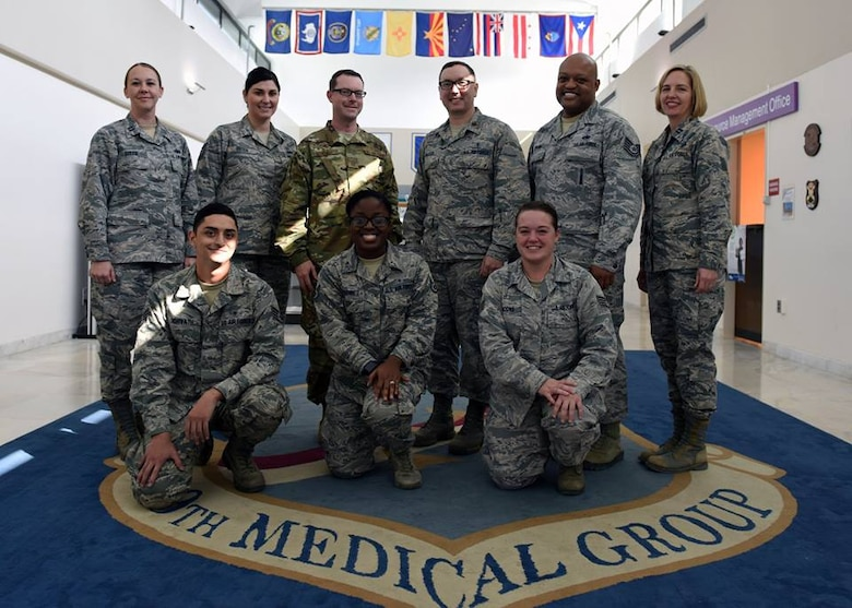 Airmen from the 39th Medical Operations Squadron mental health flight pose for a group photo.