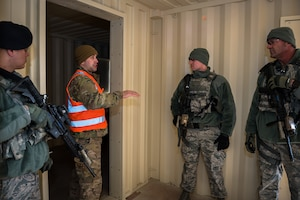 A sergeant gives feedback during active shooter training.