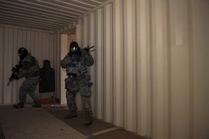 A fire team conducts building clearing procedures.
