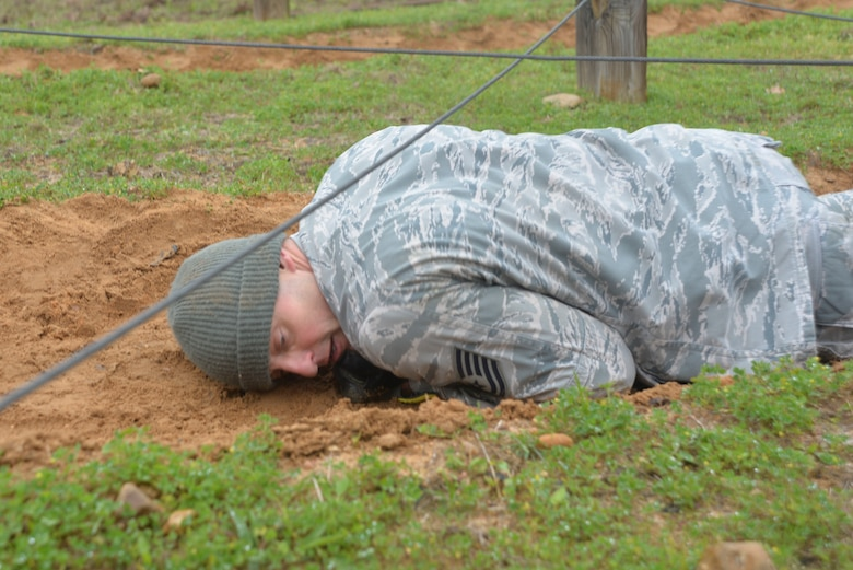 Tech. Sgt. Joshua Porter, 136th Logistics Readiness Squadron vehicle maintainer, gets down and dirty low crawling through the obstacle course during the 2019 Best Warrior Competition.