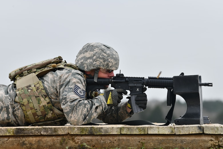 Tech. Sgt. Joshua Porter, 136th Logistics Readiness Squadron vehicle maintainer, exhibits his proficiency with the M4 carbine rifle.