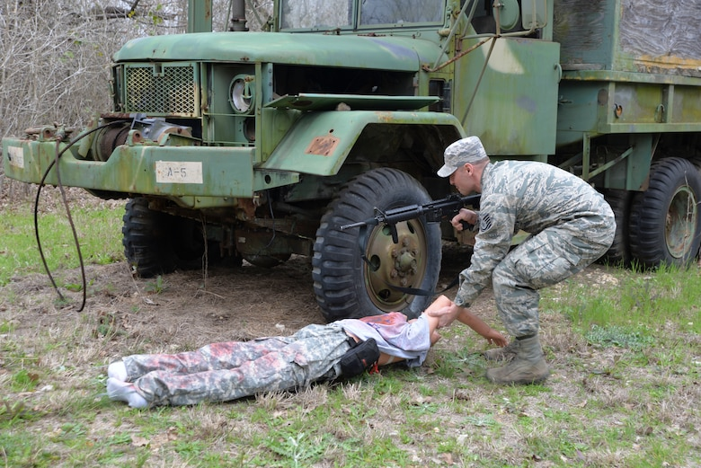 Tech. Sgt. Joshua Porter, 136th Logistics Readiness Squadron vehicle maintainer, drags a simulated casualty behind some cover during the Texas National Guard's 2019 Best Warrior Competition at Camp Swift, Texas, March 1, 2019.