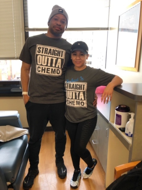 U.S. Air Force Tech. Sgt. Christopher Hicks, 92nd Operations Support Squadron aircrew flight equipment lead trainer, poses with his wife, Desiree Hicks, after completing his final chemotherapy treatment in a year long battle against colon cancer in Spokane, Washington. Hicks reached complete remission Feb. 8, 2019, through personal persistence and tenacious team support. (U.S. Air Force courtesy photo)