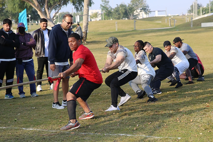 Sgt. Monique Best, center, and other members of Area Support Group-Qatar participated in Qatar's National Sports Day Feb. 12, 2019 in Doha. ASG-QA had three teams that played tug-of-war, volleyball, and soccer. Best, a human resources sergeant with ASG-QA, said that she thought the opportunity would open doors.