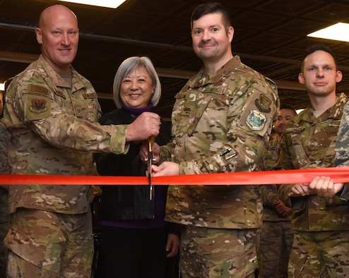 U.S. Air Force members with the 548th Intelligence, Surveillance and Reconnaissance Group, along with a member of the Beale Military Liaison Council, formally cut the ribbon signifying the grand opening of Distributed Ground Station-2's heritage room, The Vault, at Beale Air Force Base, California, March 5, 2019. The tradition of heritage rooms comes from flying crews and exists as a way for Airmen to recognize the long history of respective squadrons. (U. S. Air Force photo by Senior Airman Douglas Lorance)