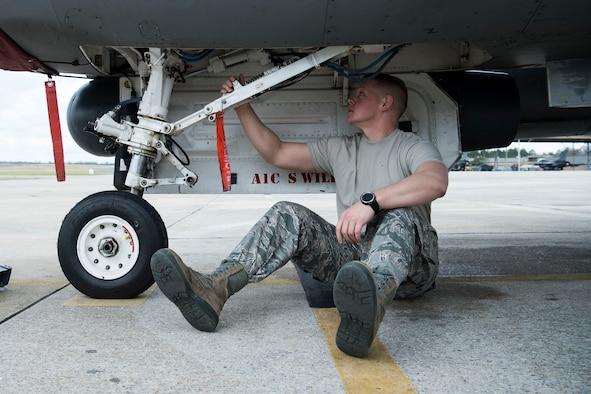 Staff Sergeant Jonathan Gill Inspects F-16