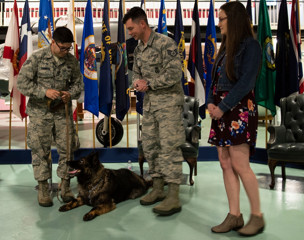 96th Security Forces Squadron holds a retirement ceremony to honor Military Working Dogs, Roy and Zuzu at the Air Force Armament Museum.