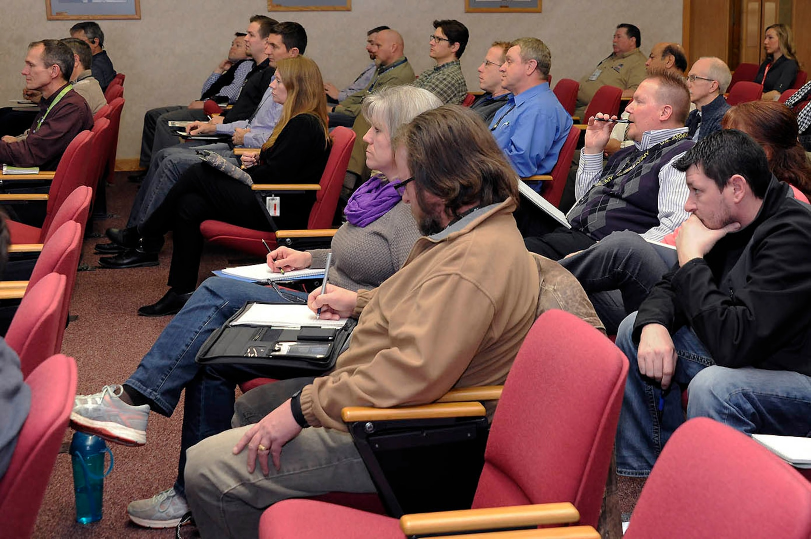 Active duty, veterans and spouses alike listen to how they can become beekeepers.