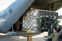 Humanitarian aid, including medical supplies, is loaded on a U.S. Air Force C-130J cargo aircraft for transport to Cúcuta, Colombia.