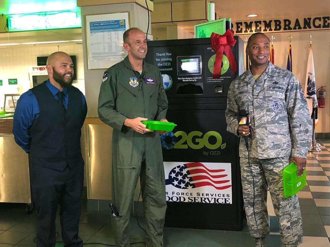 From left: David Behrendt, 412th Force Support Squadron; Brig. Gen. E. John Teichert, 412th Test Wing commander; and Chief Master Sgt. Roosevelt Jones, former 412th TW command chief; discuss the new reusable food containers at the Joshua Tree Dining Facility last year. (Courtesy photo)