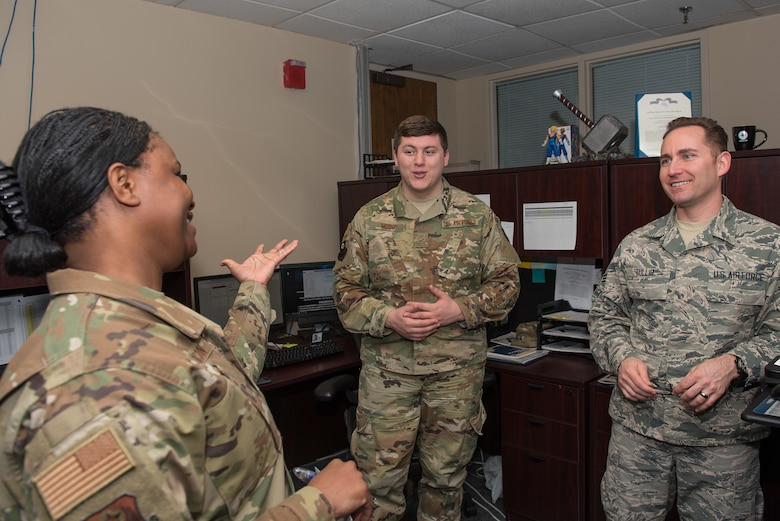 Master Sgt. Teisha Jackson, 27th Special Operations Wing Staff Agency first sergeant, tells two of her Airmen about a resiliency retreat they could go on at Cannon Air Force Base, N.M., Feb. 27th, 2019. Jackson explained that taking care of her Airmen is a key priority. (U.S. Air Force photo by Airman 1st Class Vernon R. Walter III)