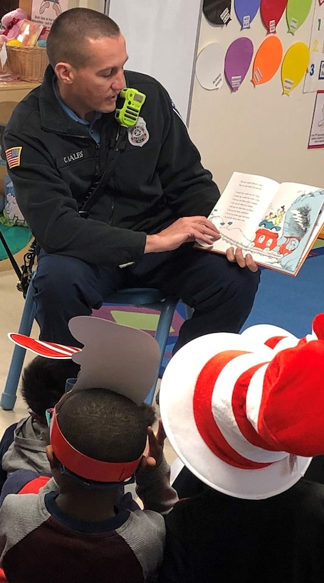 firefighter read to children on Dr. Seuss Day