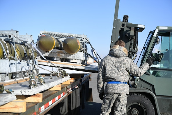 Airman 1st Class Jared Massey, 649th Munitions Squadron, directs the transfer of BLU-109 Penetrator bombs off the truck into an earth-covered storage magazine at Hill Air Force Base, Utah, during a readiness inspection Jan. 30, 2019. (U.S. Air Force photo by Cynthia Griggs)