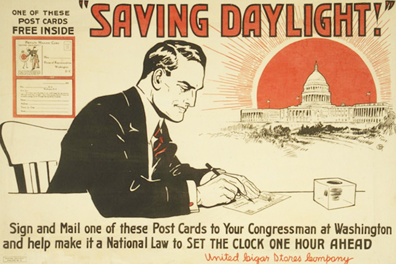 Poster showing a man writing a postcard with the U.S. Capitol in the background.