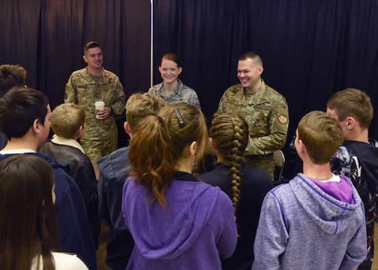 U.S. Air Force members answer questions from students of the Water Valley Independent School District at the youth career fair, Careers Y'all, at the McNease Convention Center, in San Angelo, Texas, March 6, 2019. The military members volunteered their time to showcase their career fields and mentor youth. (U.S. Air Force photo by Airman 1st Class Abbey Rieves/Released)