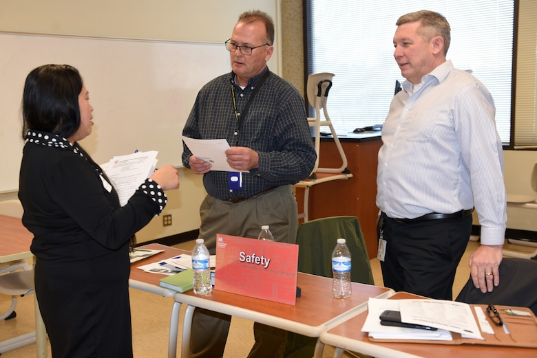 Don Busbice (Center), U.S. Army Corps of Engineers Safety chief, and Paul Burress, Nashville District industrial hygienist, meet with Annalyn Jones, president of Annalyn ANG Jones Distribution LLC., in Chattanooga, Tenn., during the Business Opportunities Open House March 6, 2019 at Tennessee State University's Avon Williams Campus in Nashville, Tenn. (USACE photo by Lee Roberts)
