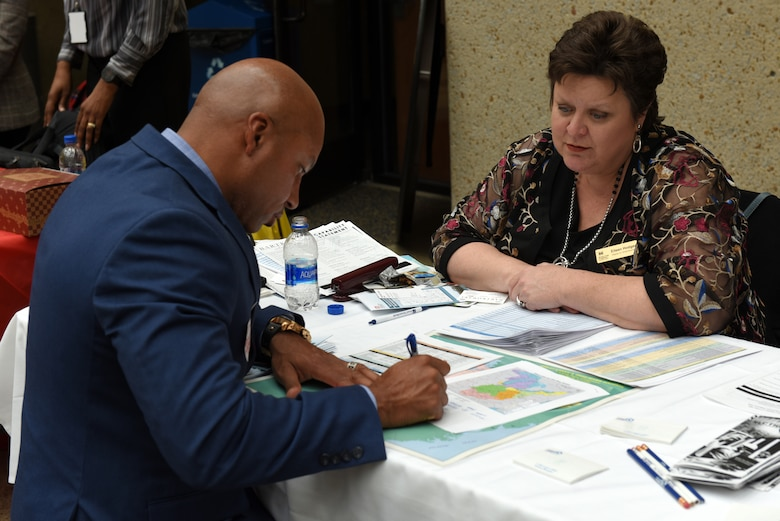Eileen Hodges, U.S. Army Corps of Engineers Huntington District deputy for Small Business, provides contracting forecast info to Craig Stevens, president of Genesis 360 Construction in Baton Rouge, La., during the 9th Annual Small Business Industry Day March 6, 2019 at Tennessee State University's Avon Williams Campus in Nashville, Tenn. (USACE photo by Lee Roberts)