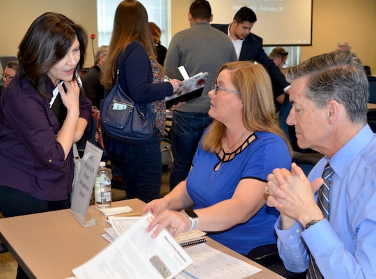 Juliana Montoya, chief, Military & IIS Section (center); and Michael Goodrich, chief, Military & IIS Project Management Branch, visit with an interested contractor during the District's Industry Day, Feb. 6, 2019.