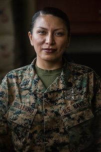 Petty Officer 2nd Class Nancy Guillermo, a religious program specialist with 1st Marine Aircraft wing, stands at attention on Camp Foster, Okinawa, Japan, Feb. 5, 2019.