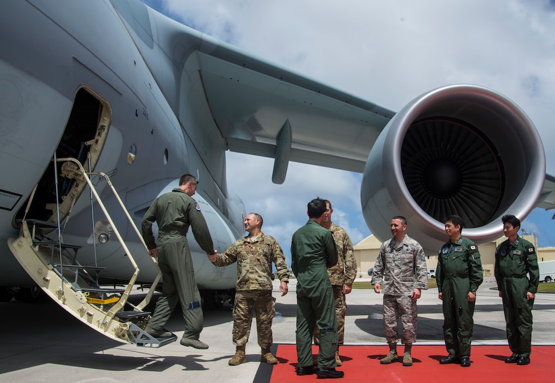 U.S. Air Force Lt. Gen. Kevin Schneider (left), 5th Air Force commander, and Koku Jieitai (Japan Air Self-Defense Force) Lt. Gen. Shigeki Muto, Air Defense commander, exits out of a Koku Jieitai Kawasaki C-2 and is greeted by U.S. base commander and COPE North 19 leadership at Andersen Air Force Base, Guam, Mar. 7, 2019.