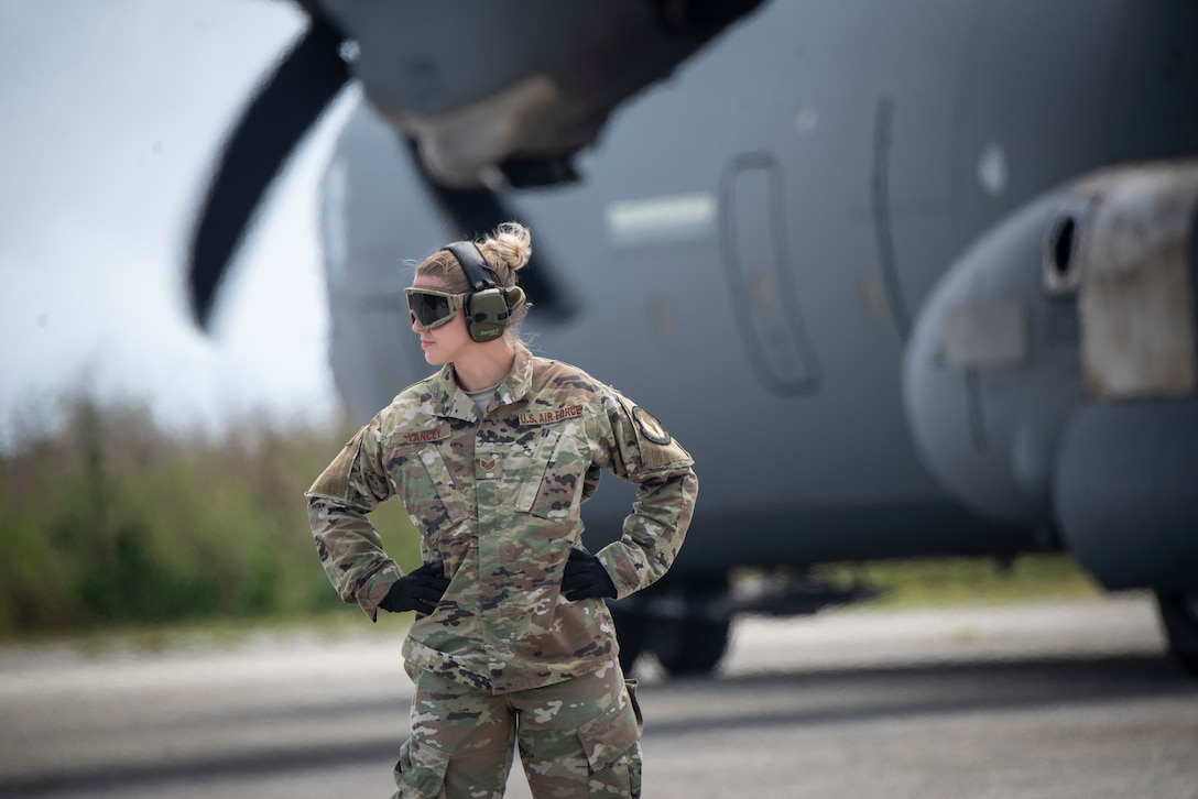 U.S. Air Force Staff Sgt. Holly Yancey, 36th Mobility Response Squadron aerial porter supervisor, from Andersen Air Force Base, Guam waits to direct passengers on the flight line during Cope North 2019 at Tinian, U.S. Commonwealth of the Northern Mariana Islands, Feb. 27, 2019.