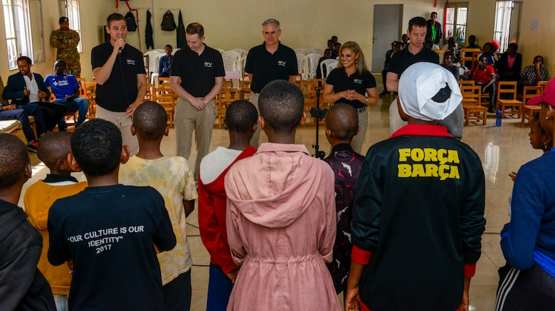 U.S. Airmen assigned to the U.S. Air Forces in Europe Band introduce themselves to the choir at the Gisimba Memorial Centre in Kigali, Rwanda, March 6, 2019. As musical ambassadors, members of the band can reach audiences that traditional military members can't. They travel the world to build cultural bridges, and honor and preserve cultural heritage. (U.S. Air Force photo by Tech. Sgt. Timothy Moore)
