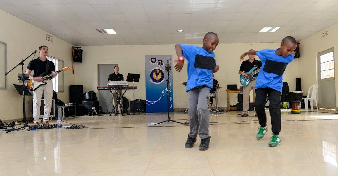 Students dance to music played by the U.S. Air Forces in Europe Band Touch N' Go during a performance at the Gisimba Memorial Centre in Kigali, Rwanda, March 6, 2019. As musical ambassadors, members of the band can reach audiences that traditional military members can't. They travel the world to build cultural bridges, and honor and preserve cultural heritage. (U.S. Air Force photo by Tech. Sgt. Timothy Moore)