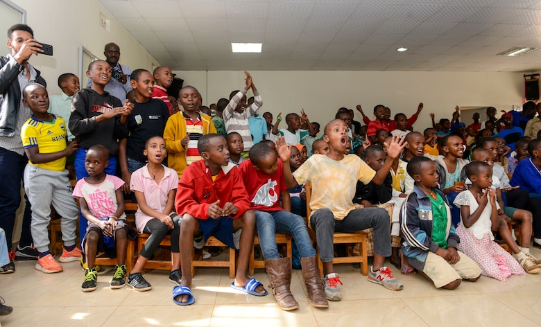 Students sing and clap along to music played by the U.S. Air Forces in Europe Band Touch N' Go during a performance at the Gisimba Memorial Centre in Kigali, Rwanda, March 6, 2019. As musical ambassadors, members of the band can reach audiences that traditional military members can't. They travel the world to build cultural bridges, and honor and preserve cultural heritage. (U.S. Air Force photo by Tech. Sgt. Timothy Moore)