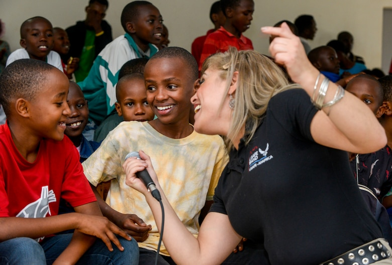 Students sing along with U.S. Air Force Senior Airman Linda Casul, U.S. Air Forces in Europe Band vocalist, during a performance at the Gisimba Memorial Centre in Kigali, Rwanda, March 6, 2019. As musical ambassadors, members of the band can reach audiences that traditional military members can't. They travel the world to build cultural bridges, and honor and preserve cultural heritage. (U.S. Air Force photo by Tech. Sgt. Timothy Moore)