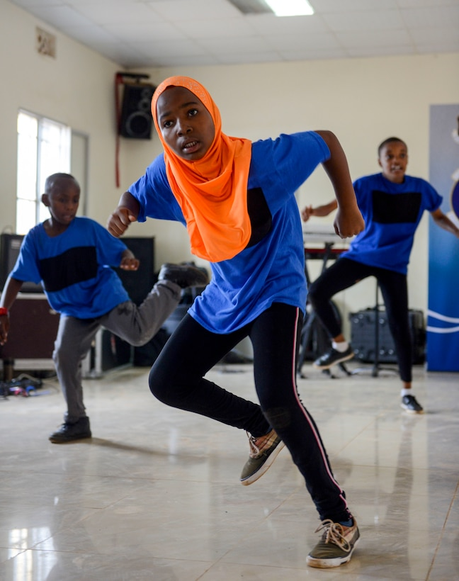 Students perform a dance at the Gisimba Memorial Centre in Kigali, Rwanda, March 6, 2019. After watching a performance by the U.S. Air Forces in Europe Band Touch N' Go, the students wanted to perform for the band. (U.S. Air Force photo by Tech. Sgt. Timothy Moore)