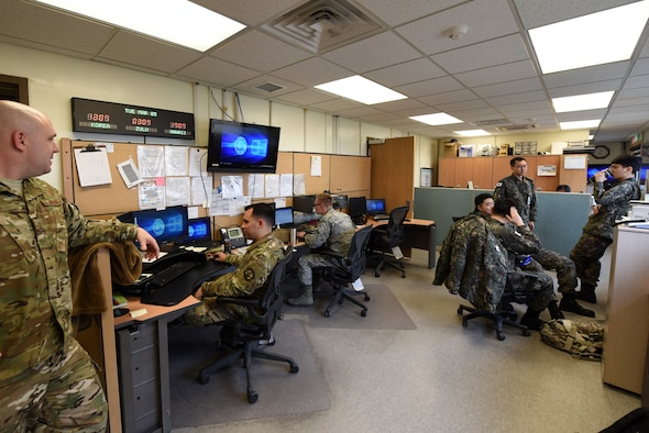 The U.S. Air Force and Republic of Korea Air Force coexist in the weather operations office at Kunsan Air Base, Republic of Korea, March 5, 2019. The team mutually benefits, sharing advanced technology and, a fundamental knowledge of local weather patterns. (U.S. Air Force photo by Staff Sgt. Joshua Edwards)