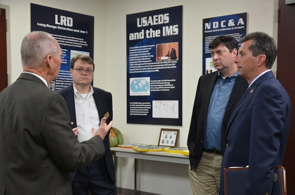 Mr. Jim Whidden, director of staff for the Air Force Technical Applications Center, briefs staff members from Rep. Bill Posey's (FL-8) office in AFTAC's Heritage Room at Patrick Air Force Base, Florida.  The staffers visited the nuclear treaty monitoring center March 4, 2019 to learn more about AFTAC's heritage and global mission.  Pictured from left to right: Whidden; Stuart Burns, chief of staff; Rick Podliska, senior policy advisor; and Patrick Gavin, district director.  (U.S. Air Force photo by Susan A. Romano)