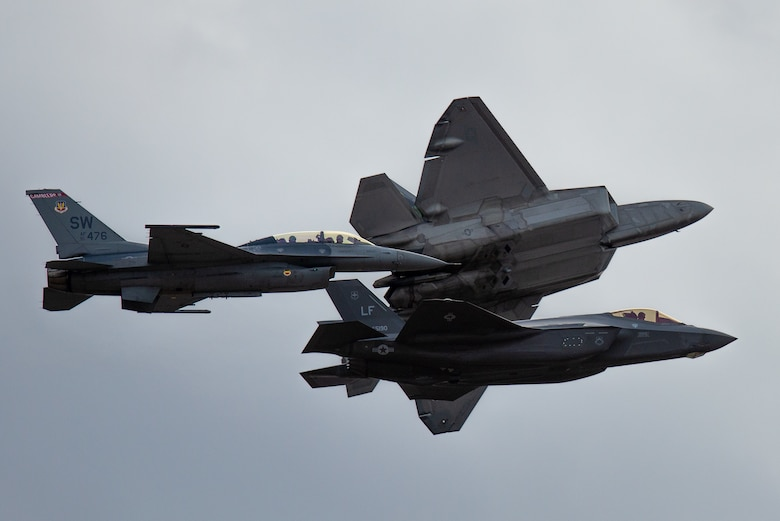 F-16 Viper, F-35 Lighting II and F-22 Raptor fly in formation