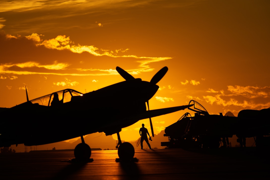 Sunset silhouette of planes on a flightline