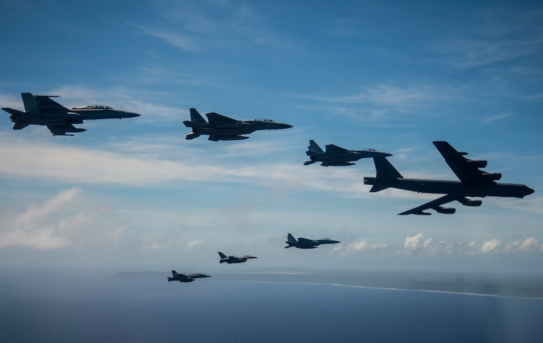 Aircraft from the U.S., Australia and Japan participating in exercise COPE North 2019 engage in a large show-of-force formation