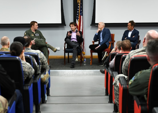 Lt. Col. Timothy Tendall, 48th Fighter Wing chief of flight safety, facilitates a discussion between three business leaders and U.S. Air Force officers during a leadership panel at Royal Air Force Lakenheath, England, in the Strike Eagle Complex auditorium March 1. The event's topics included how the panelists develop teams, select leaders and solve problems in their companies. (U.S. Air Force photo by Senior Airman Malcolm Mayfield)