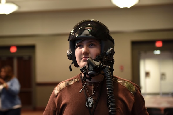 Payne Tomilinson, a Corinth High School student, wears a pilot helmet at Mississippi State University's Engineering Day March 4, 2019, in Starkville, Mississippi. A three-man team from Columbus Air Force Base connected with over 350 students from Texas, Louisiana, Alabama and Mississippi at the space-