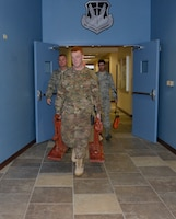 (L-R) Master Sgt. Keith Brown, Staff Sgt. Jeremy Overturf, and Staff Sgt. Anthony Martin, all from the 241st Engineering Installation Squadron, Chattanooga, Tenn., carry communications cable equipment into the 1st Air Force (Air Forces Northern) Headquarters building. They are part of a group of seven Airmen from the 241st EIS who deployed here to assist the 1st AF (AFNORTH) enterprise to restore its communications and computer capabilities following the devastating effects of Hurricane Michael Oct. 10, 2018. (Air Force photo by Mary McHale)