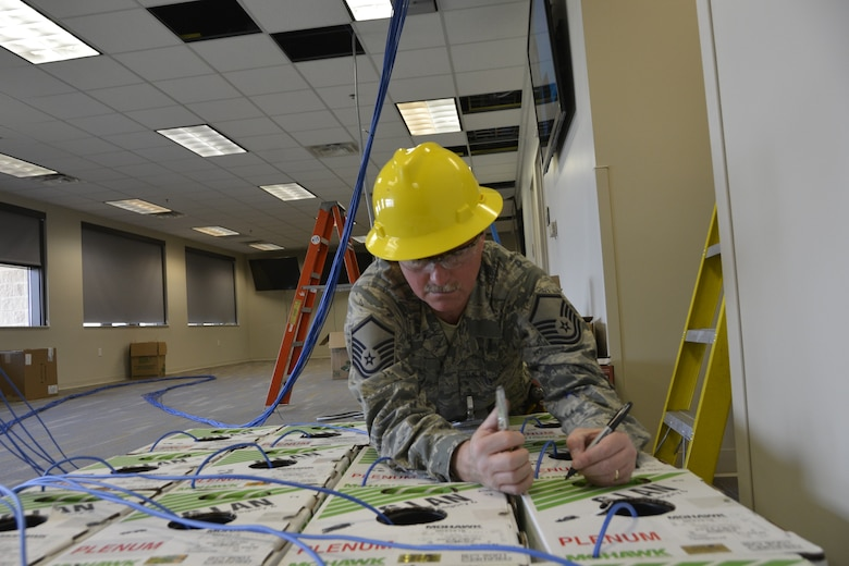 Master Sgt. Keith Brown, cyber transport specialist with the 241st Engineering Installation Squadron, Chattanooga, Tenn., marks the order of boxes of copper cable prior to installation. Brown is part of a group of seven Airmen from the 241st EIS who deployed here to assist the 1st AF (AFNORTH) enterprise to restore its communications and computer capabilities following the devastating effects of Hurricane Michael Oct. 10, 2018. (Air Force photo by Mary McHale)