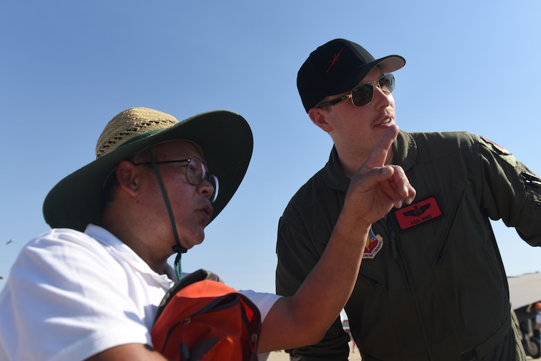 An airshow visitor asks Staff Sgt. Chandler, MQ-9 Reaper sensor operator, a question about the Reaper's targeting system during the Australian International Airshow, Mar. 2, 2019, in Geelong, Victoria, Australia. Reaper crews have made their way across the United States to attend airshows such as this one, but this is their first time in the Pacific Air Forces Command area of responsibility and Australia. (U.S. Air Force photo by Airman 1st Class Haley Stevens)