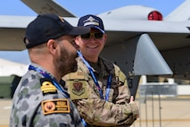 Master Sgt. Daren speaks with a member of the Australian Defence Force about the MQ-9 Reaper during the Australian International Airshow, Feb. 26, 2019, in Geelong, Victoria, Australia. In line with the focus of strengthening the relationship between the Australian Defence Force and United States Military, the U.S. Air Force and Creech Airmen brought the Remotely Piloted Aircraft to be displayed during this airpower demonstration. (U.S. Air Force photo by Airman 1st Class Haley Stevens)