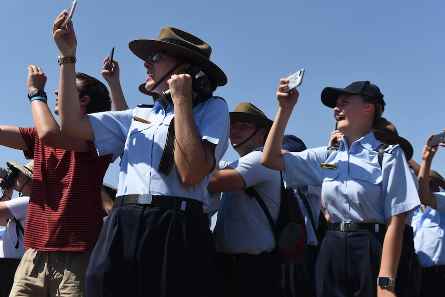 Airshow visitors raise their cameras to the sky to capture airpower in action during the Australian International Airshow, Mar. 2, 2019, in Geelong, Victoria, Australia. Over the week, the Avalon Airfield hosted more that 200,000 visitors and aviation fans. (U.S. Air Force photo by Capt. Annabel Monroe)