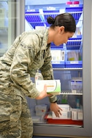 Airman Valerie Argumedo, 14th Medical Support Squadron pharmacy technician, prepares to give a customer their prescription March 4, 2019, on Columbus Air Force Base, Mississippi. Over 109,000 prescriptions are written for over 18,000 thousand beneficiaries yearly. (U.S. Air Force photo by Airman 1st Class Keith Holcomb)
