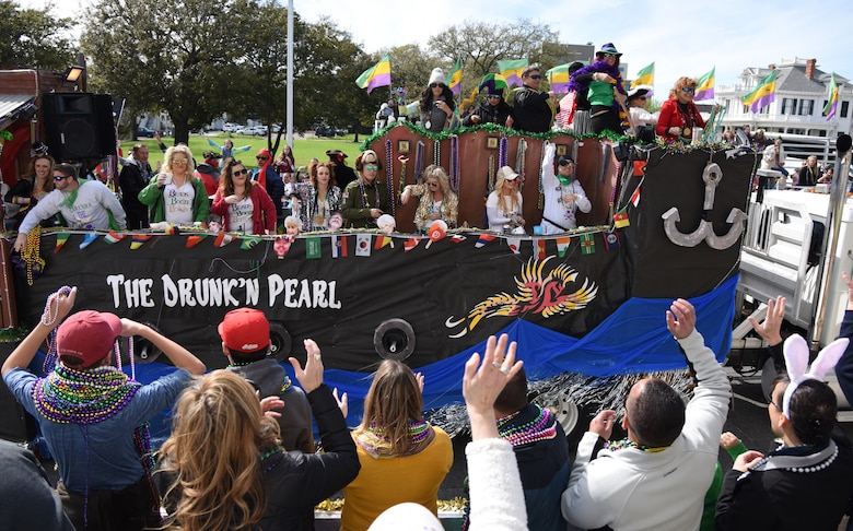Decorative floats ride through Biloxi during the Gulf Coast Carnival Association Mardi Gras parade in Biloxi, Mississippi, March 5, 2019. Keesler personnel participate in local parades every Mardi Gras season to show their support of the communities surrounding the installation. (U.S. Air Force photo by Kemberly Groue)
