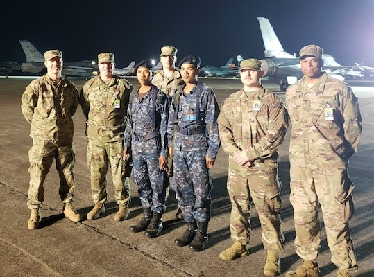 Group of Washington Air National Guardsmen with their Royal Thai Air Force counterparts stand guard at Korat Royal Thai Air Base, Thailand.